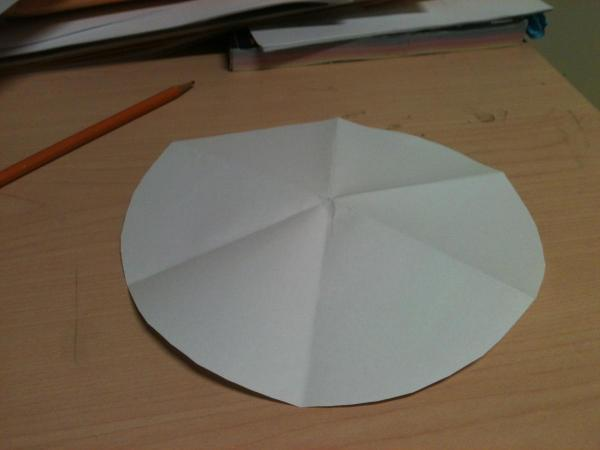 Paper folded into circular sixths