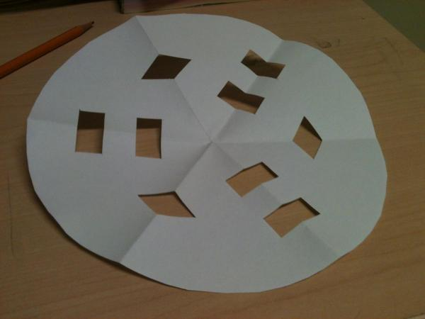 Paper folded into sixths, with cut-outs