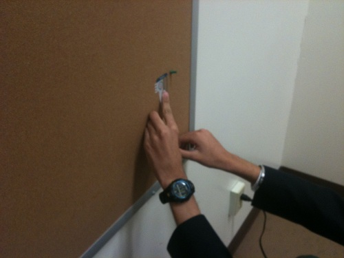 Student measuring on a wall