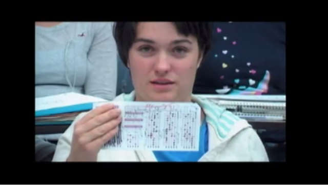 Girl holding a scantron sheet